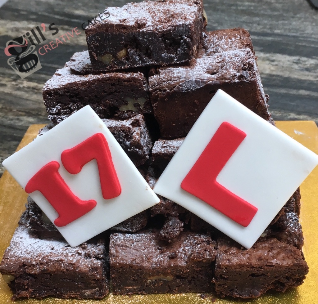 Chocolate Brownie Celebration Towers - New Product from April 2019. As an alternative to the traditional celebration cakes, I'm trialling Brownie Towers. Chocolate brownies secured together to create a tower and decorated to suit your occasion, whether its topped with a large chocolate number, hearts, flowers, sports team colours??? Please contact me to discuss. Small decorated tower - 12 brownies from £40