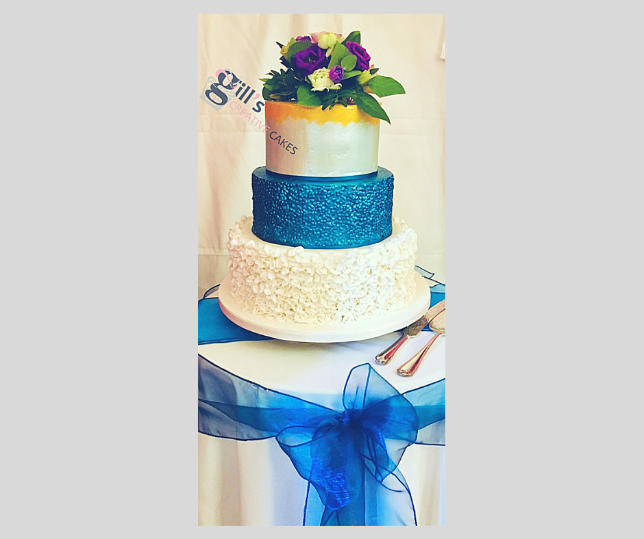 Peacock coloured Wedding Cake.png