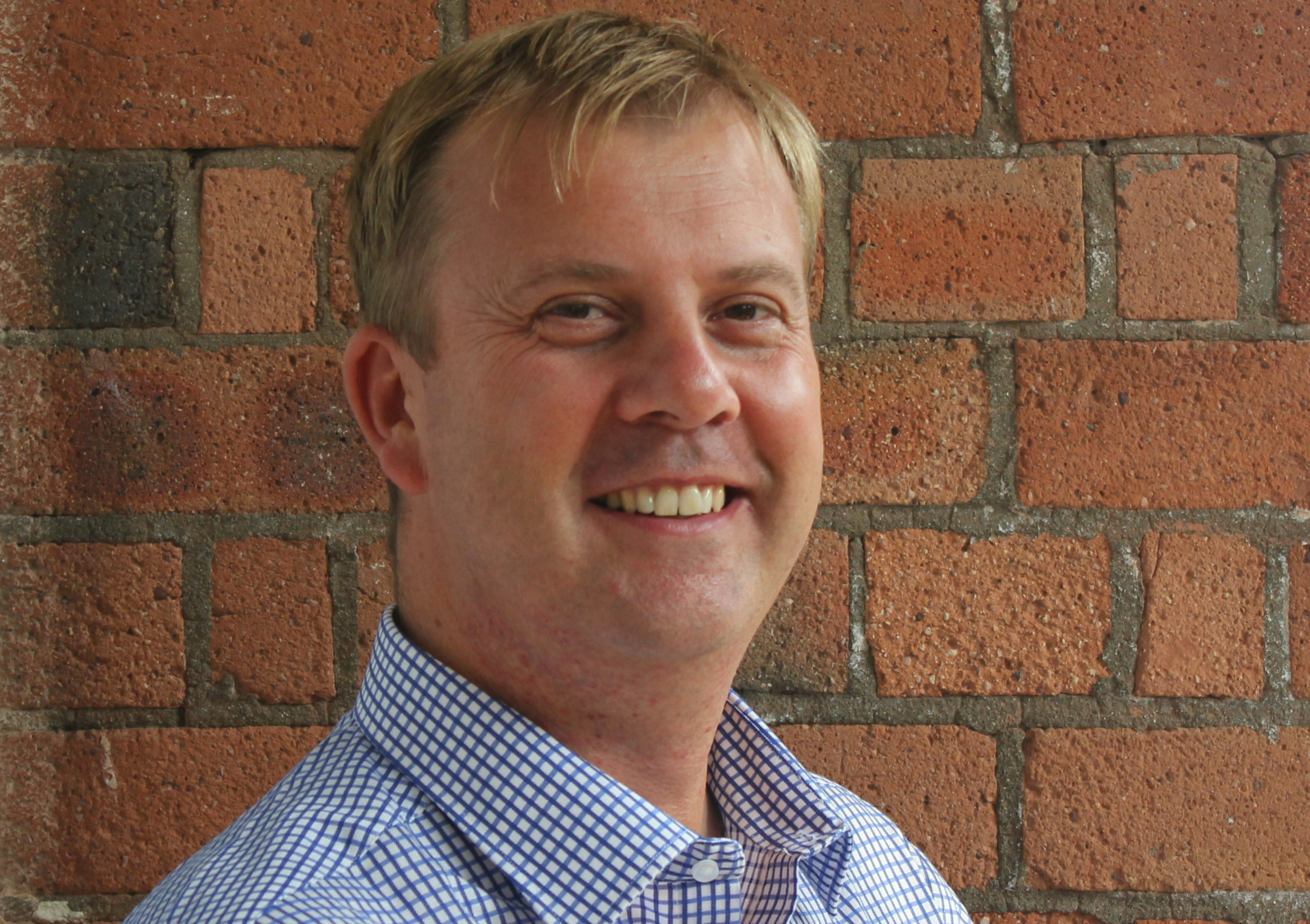 Kristian Hancock, Team Leader   Kris is perfectly positioned to head up this team. His years of experience as a head teacher help him understand the part that coaching plays in the big picture, while his personal approach makes him a superb individual coach.