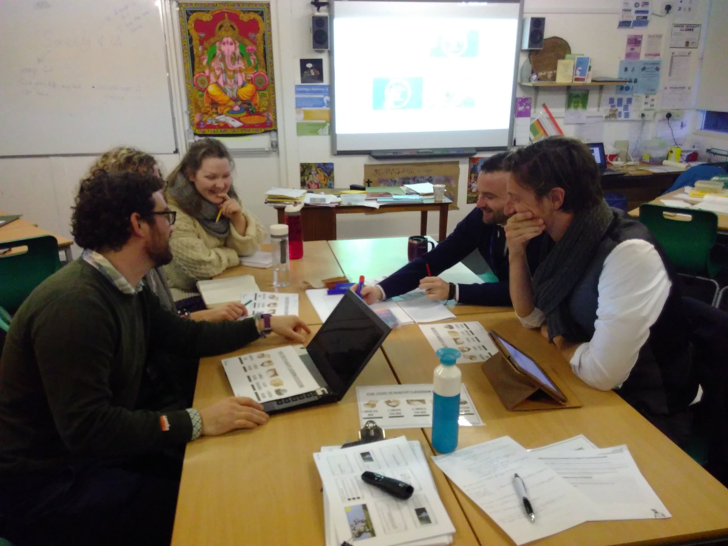 Staff discussing the ThoughtBox Five-Step approach to healthy classroom discussions.