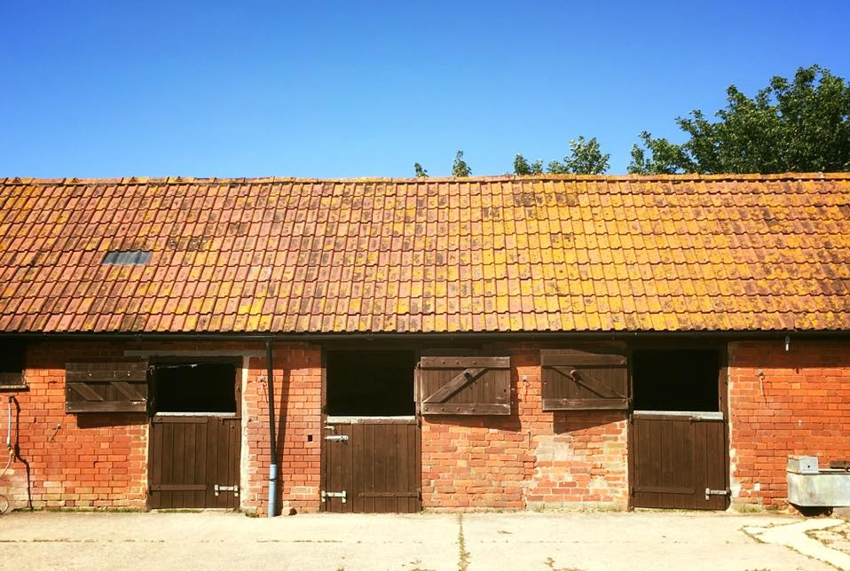 TRADITIONAL HUNT STYLE STABLES ON A LARGE ENCLOSED YARD
