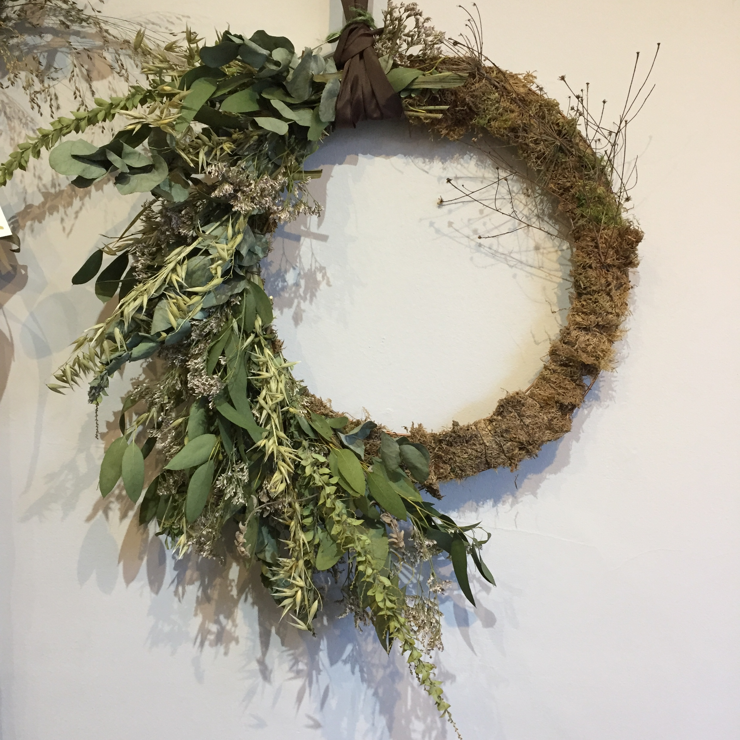 A beautiful Wreath - Wreath by Sophie Millington, they smell divine and this one with all its dried elements would last a good season or two. Available at 14 Castle St Exeter