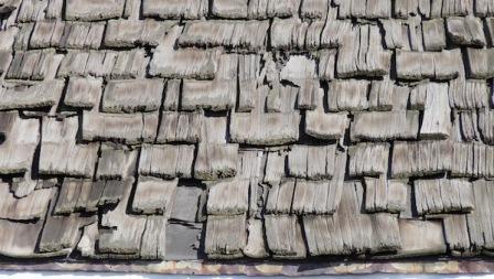 cedar-shake-shingles-worn-out-missing-shingles-on-roof.jpg