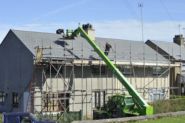 roofing-contractor-on-asphalt-shingle-roof.png