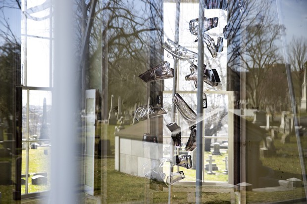 Meier's article included this photograph of Leo Tecosky's installation viewed through a window, reflecting the surrounding cemetery at The Woodlands. Photo by Ryan Collerd.