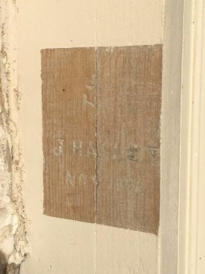 19th century inscription carved into the woodwork of the Woodlands mansion's south porch.