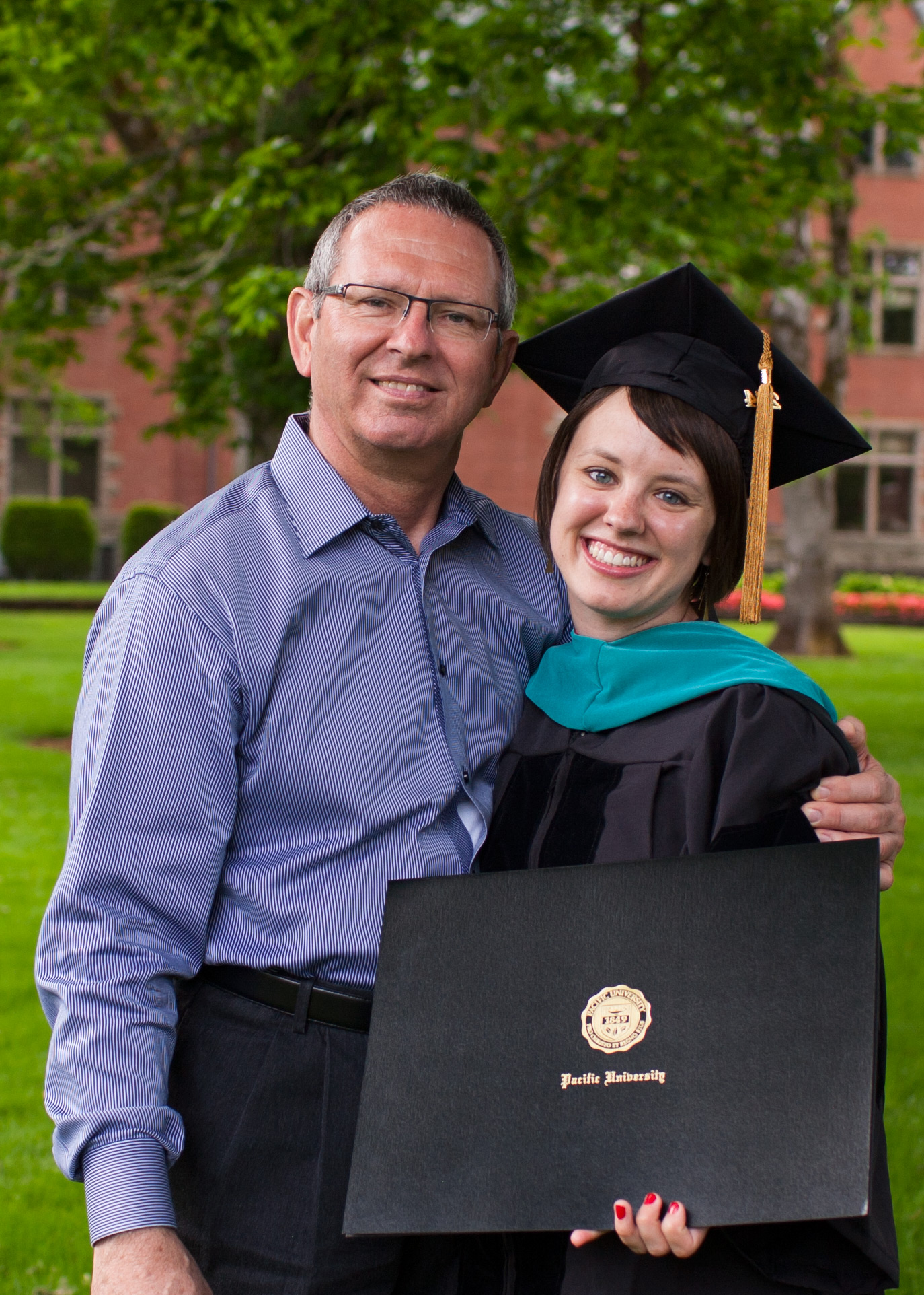 Dr. Mel Farnsworth and Dr. Ashley Ayers at her graduation from Pacific University