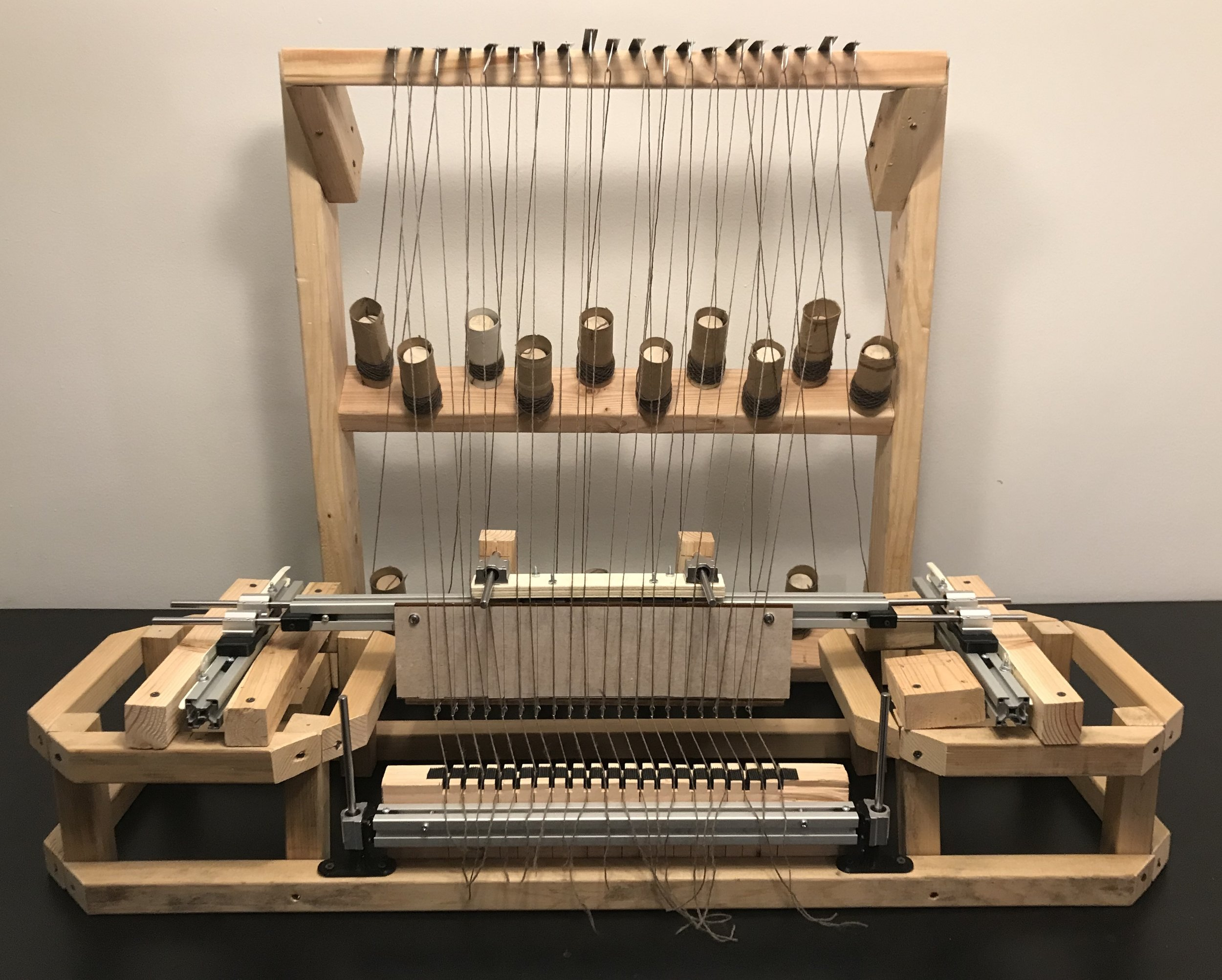 Warp Knitting Machine Prototype  - I created a threading mechanism for an at home warp knitting machine that decreases the loading time by 45%