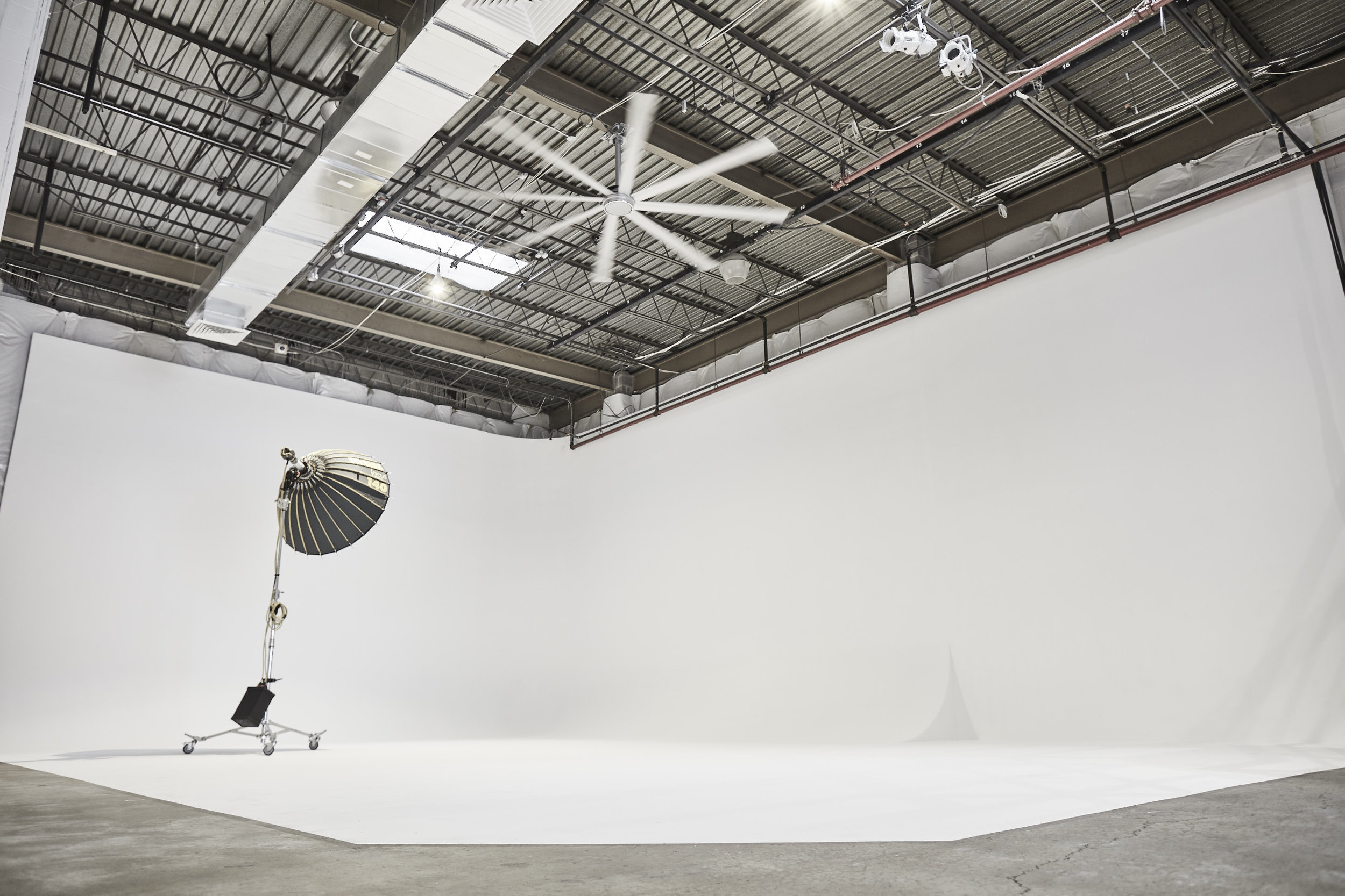 Photo & Film Studio   7,000 SF Cyclorama Studio, 20' Tall Ceilings Drive-in / Full Turn, Adjacent Industrial Studio, Patio, Private Parking, Client Lounges, Green Rooms, Mezzanine, Roof Top, Kitchenette, Blackout or Natural Light, High Speed WIFI, Surround Sound, 600amp, and Lifts