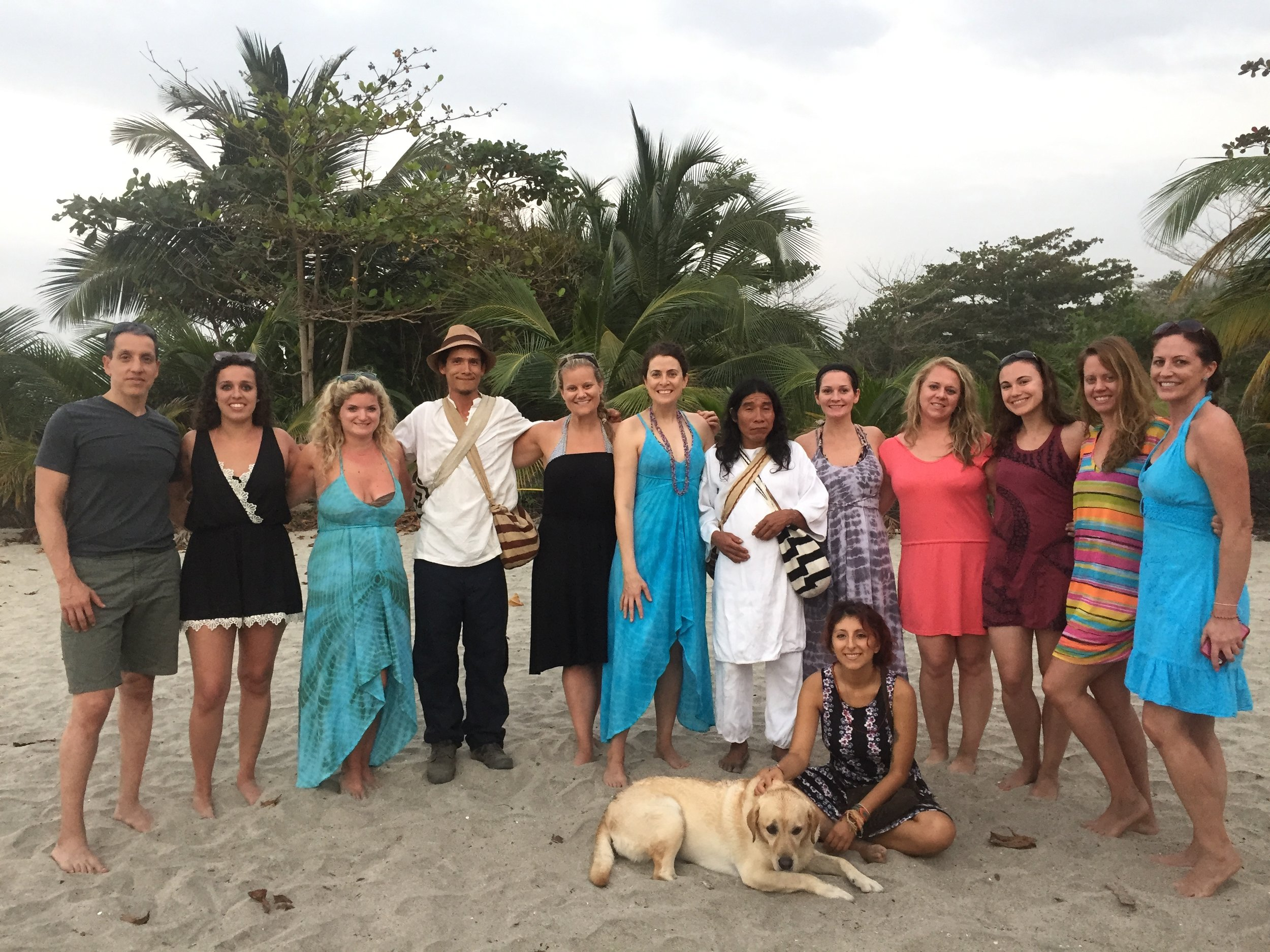 Joyful with Kogis and canines in Colombia. The Kogis are one of the numerous indigenous tribes in Colombia. They believe in the sacredness of Mother Earth.