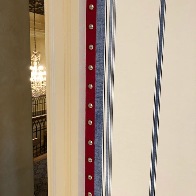 Trim detail with nailheads in a bedroom and bathroom.....looks cool! #customworkroom #atlantacustominteriors #itsallinthedetails