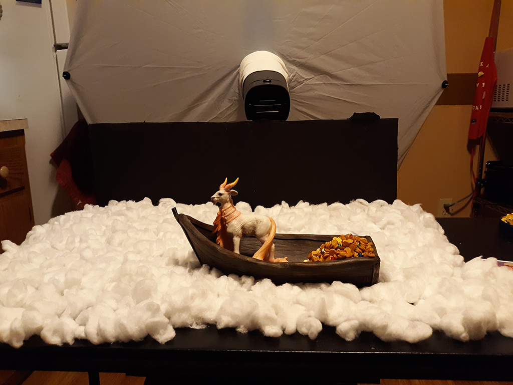 Toy Goat in a Foam Boat with Cotton Ball Clouds