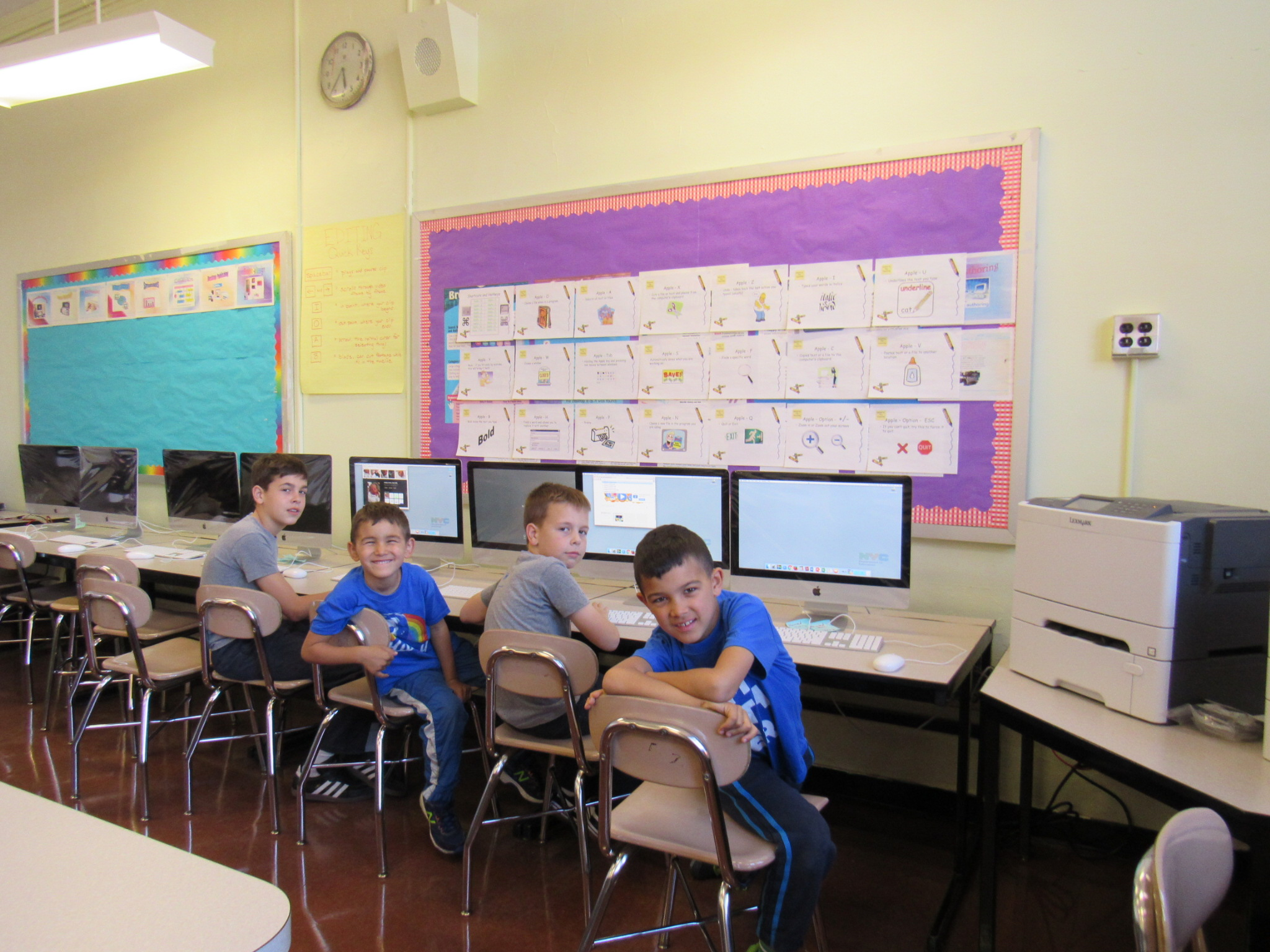 our computer lab - At P. S. 110, we believe that computer technology is a valuable tool to enhance teaching and learning. Our students use a variety of technologies to access, analyze, interpret, synthesize, apply, communicate and present information. They learn and practice various skills: keyboarding, desktop publishing, creating multimedia projects, digital photography and videography, painting and illustrating, web authoring, creating spreadsheets and databases, graphing and charting, graphic designing, internet researching, and basic programming.We have a dedicated instructional computer lab of 30 iMac workstations networked through an Apple X-server, and we also have deployed 5 mobile carts of iBooks, a total of 80 laptops, on various floors for classrooms to use. Every classroom is wired for internet connection, and each classroom has 2-3 computers. All laptop computers can access the internet wirelessly.Thanks to the RESO A grant, each classroom now has a media cart which houses an Elmo document camera, an LCD projector, a laptop, and a built-in stereo sound system. It is a valuable tool for teachers to use in the classroom for teaching, presentation, demos, and brainstorming.