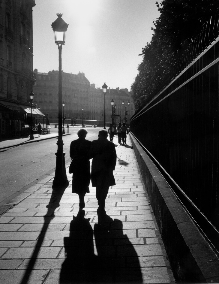 City of Light.  Walking out of Cathedral Notre Dame after morning Mass, I saw the couple in front of me cast shadows alongside the street lamp.