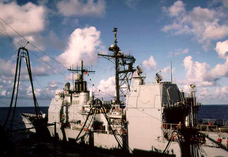 USS Detroit (AOE-4) resupplies the guided missile cruiser USS Normandy (CG-60). Atlantic Ocean, March 1990. Kodachrome 64.