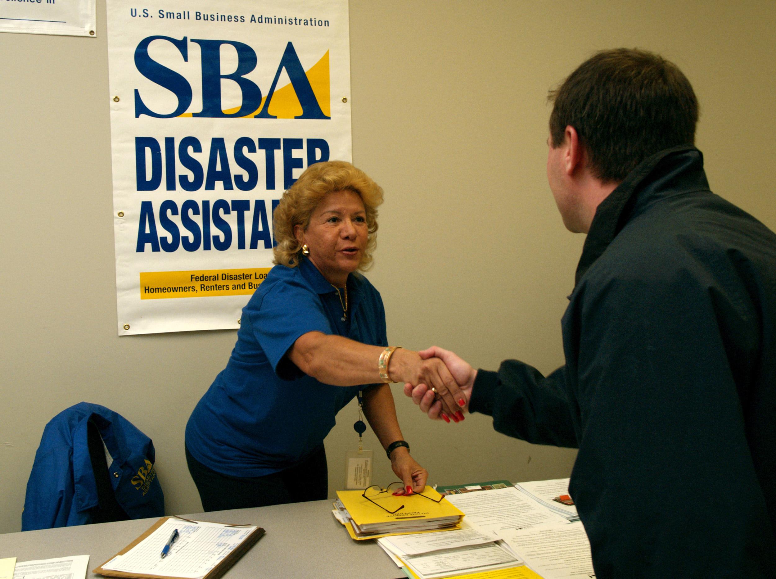 FEMA_-_30747_-_SBA_worker_shakes_hands_with_FCO_in_South_Dakota.jpg