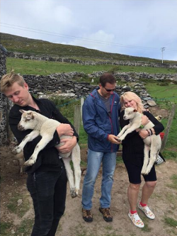 My brother Tyler with my dad, mom, and baby sheep in Dingle.