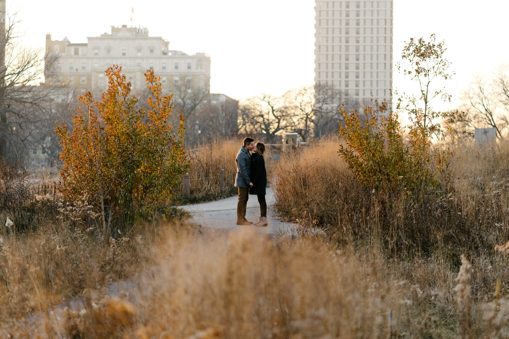 021-rempel-photography-chicago-wedding-photography-christina-paul-lincoln-park-engagement-session-second-city-bar.jpg
