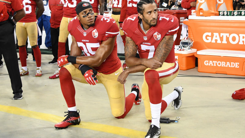 Eric Reid and Colin Kaepernick kneel during the National Anthem before a game against the Los Angeles Rams on September 12, 2016.