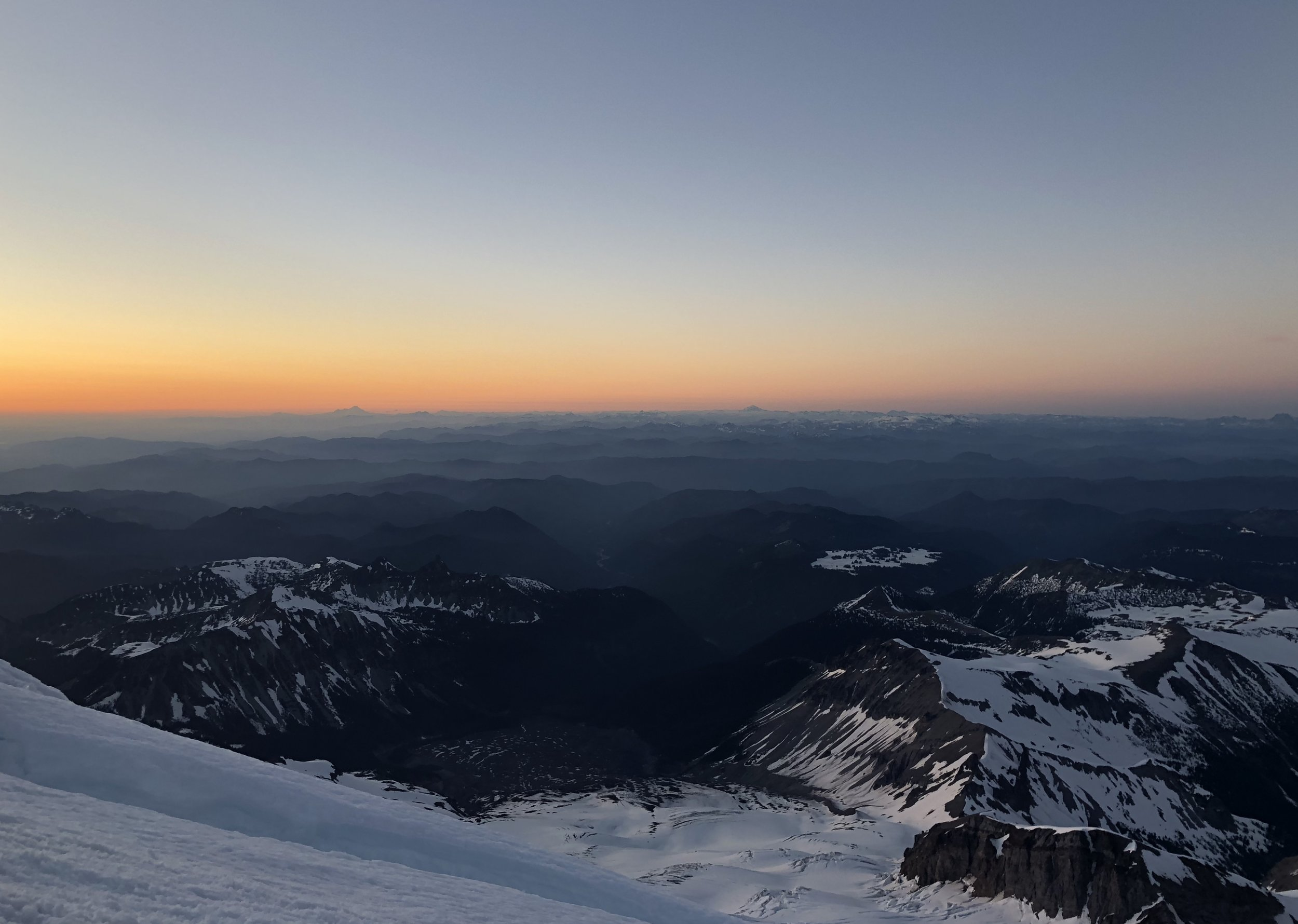 The sun setting from the Emmons Glacier on Mount Rainier.