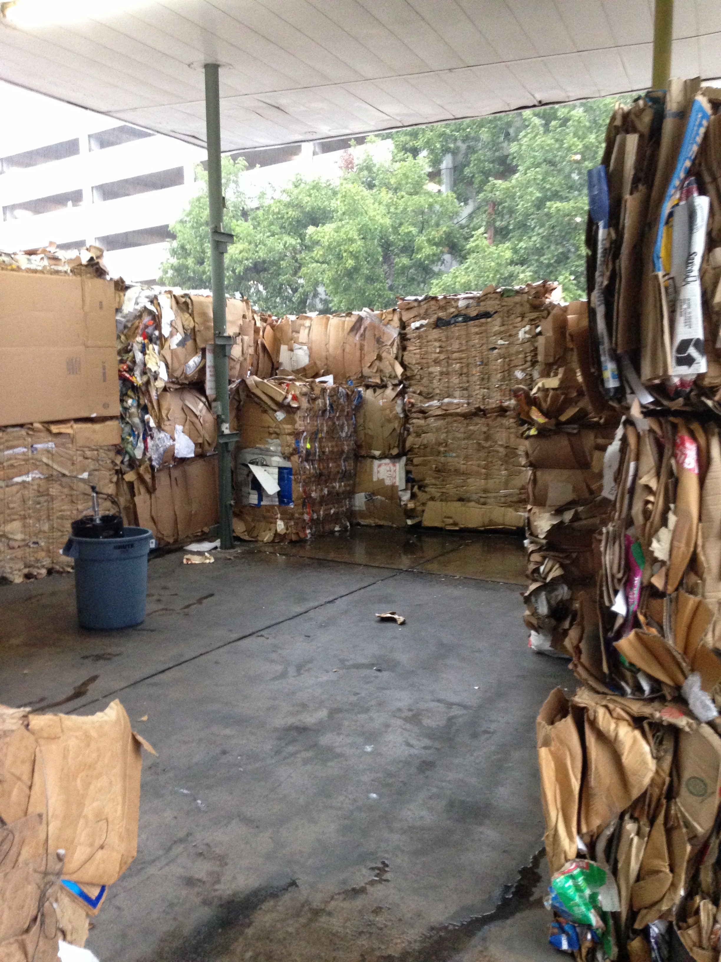 The exhibition space was constructed entirely out of 1200 lb bales of OCC (the recycling industry term for old corrugated cardboard/containers) underneath the awning of the recycling center.