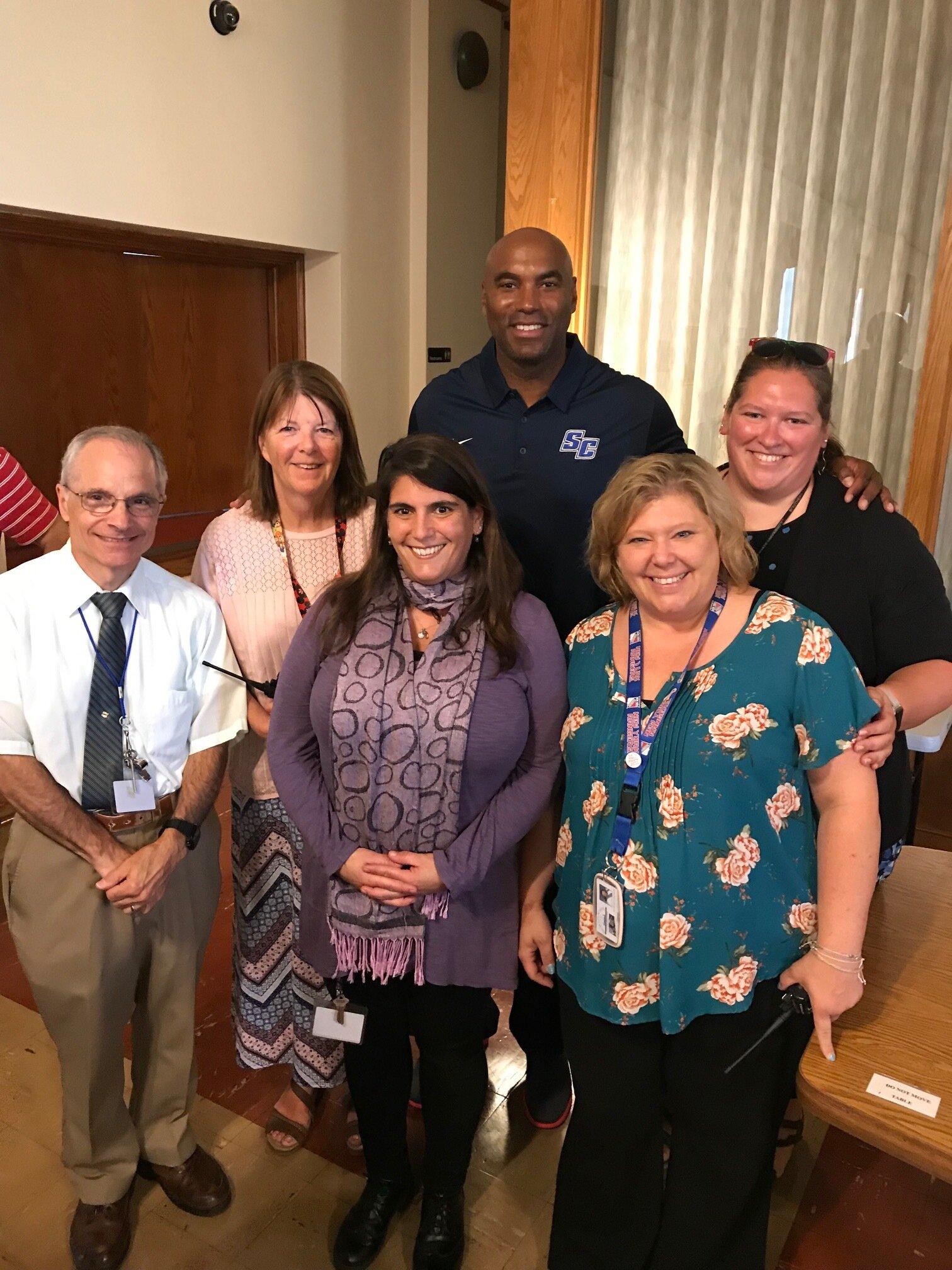 Burrell with teachers.jpg
