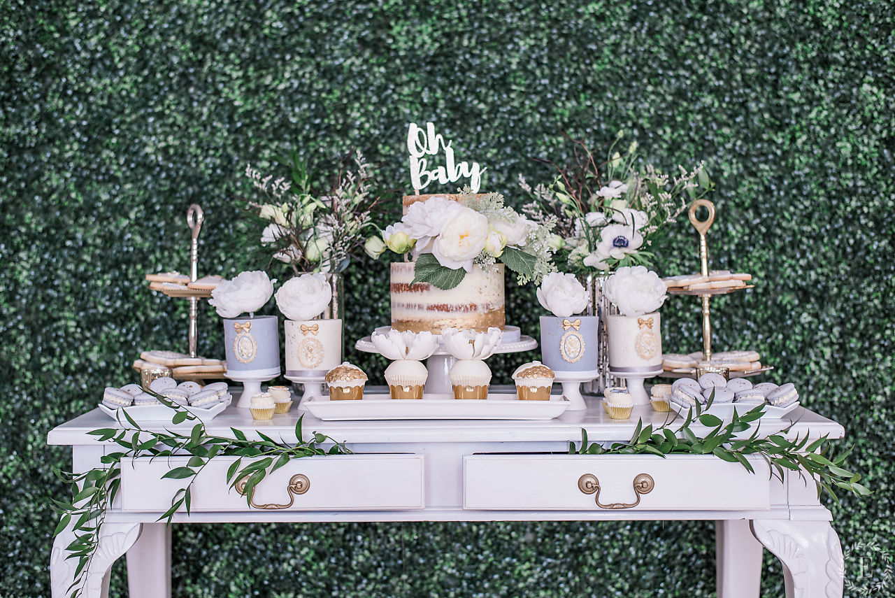 When I walked in to see this set up, I was in awe!! I couldn't believe how beautiful it turned out. From the green background, to the floral arrangements and the detailed custom made desserts to fit the theme. They were way too pretty to eat!! Some of my guests even thought the mini cakes were candle holders!