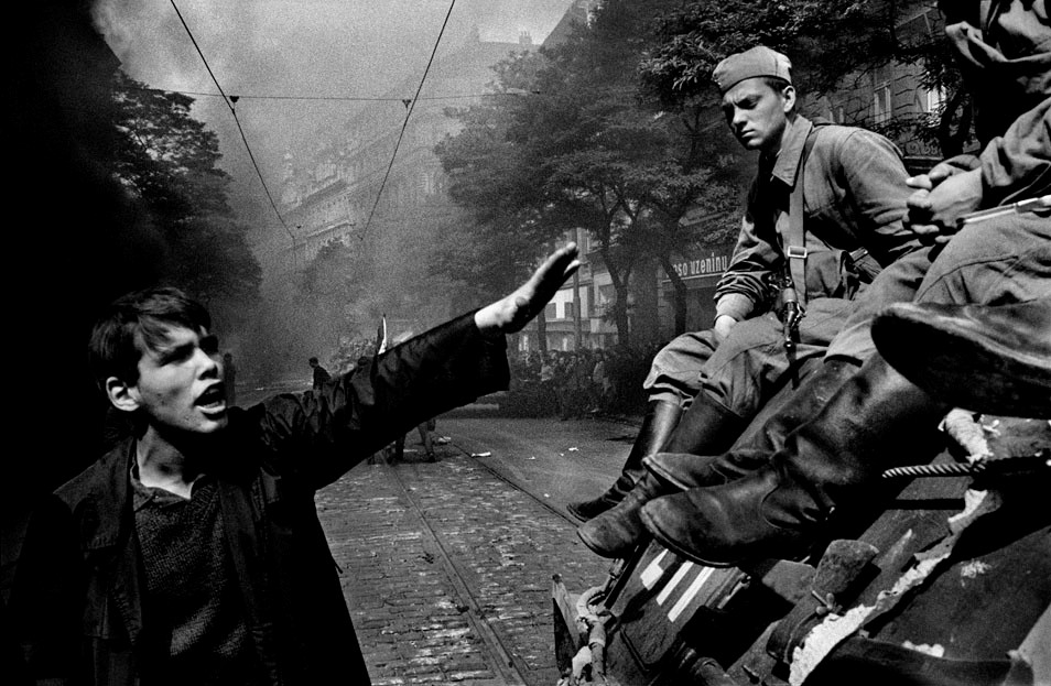 A young Czech man rebukes Soviet Soldiers.