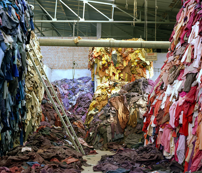 Cast-off woolen clothing being sorted in large warehouses in Panipat. Photo by  Tim Mitchell .