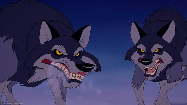 """These wolves from  Beauty and the Beast  (1991) help reinforce stereotypes of """"evil wolves"""". (c) Gary Trousdale and Kirk Wise, image from  Disney Wikia ."""
