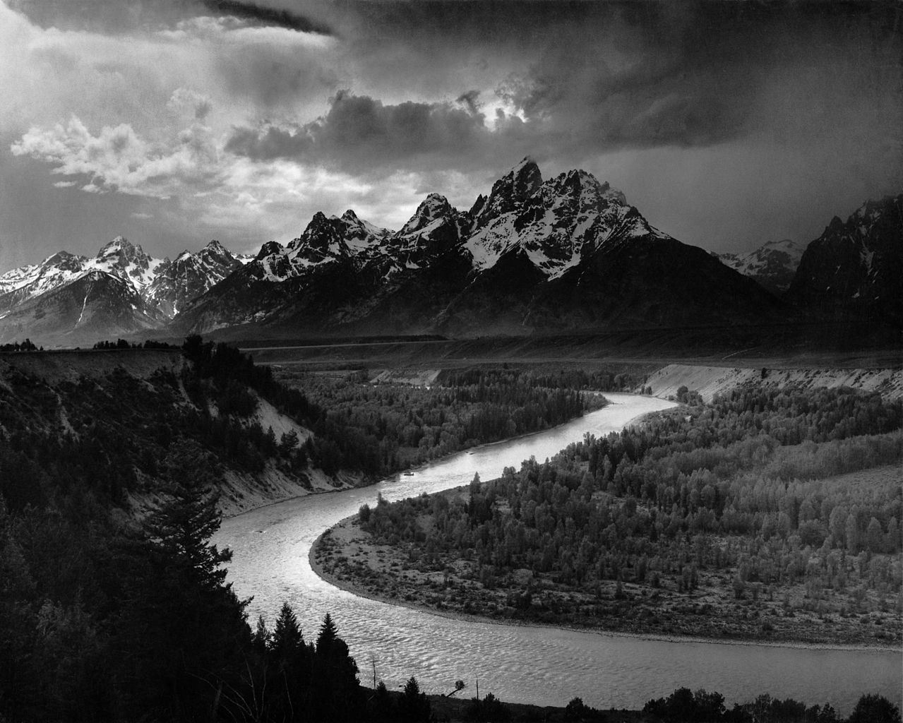 Tetons and the Snake River by Ansel Adams, 1942. This image is now traveling through deep space aboard Voyager 1.