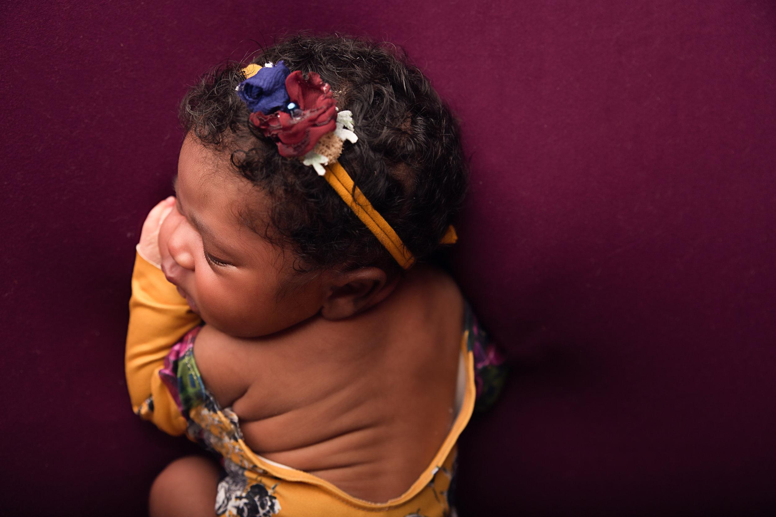 newborn photographer charlotte nc burgundy yellow romper.jpg