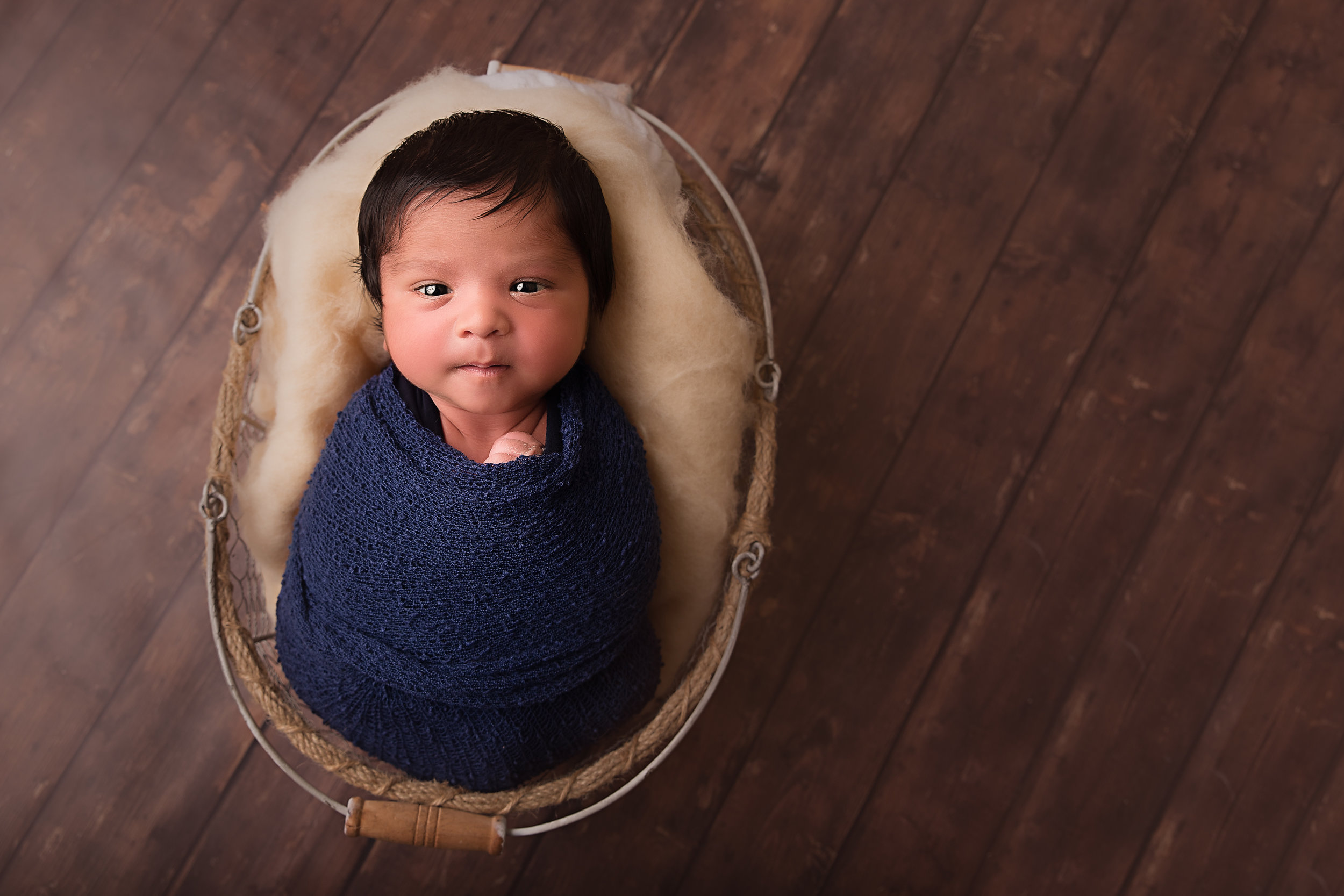 charlotte newborn photographer keeping baby safe during session.jpg