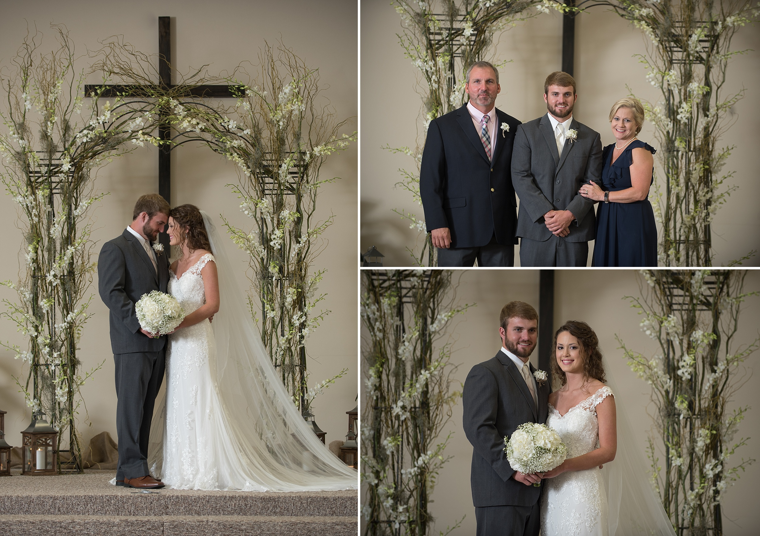 wooden cross and a floral arch frame the newly married couple at the alter