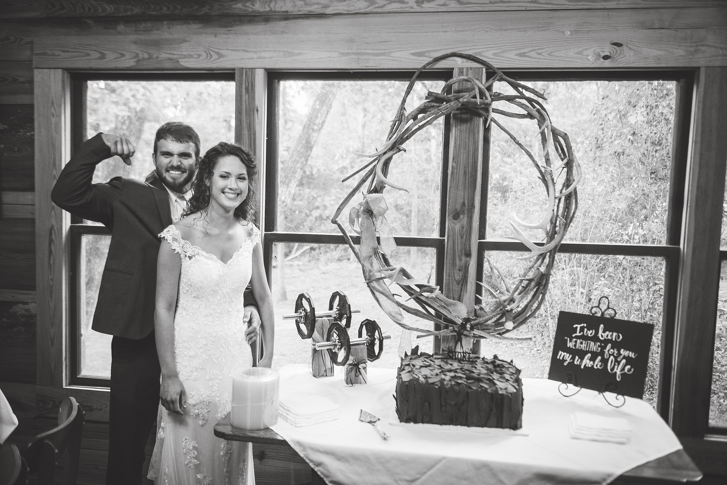 groom's cake featuring weightlifting equipment and groom flexing his bicepts