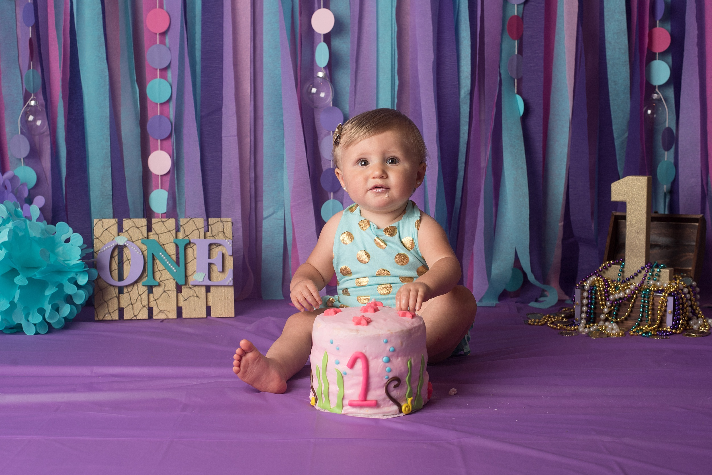 One year old girl eats her mermaid themed smash cake