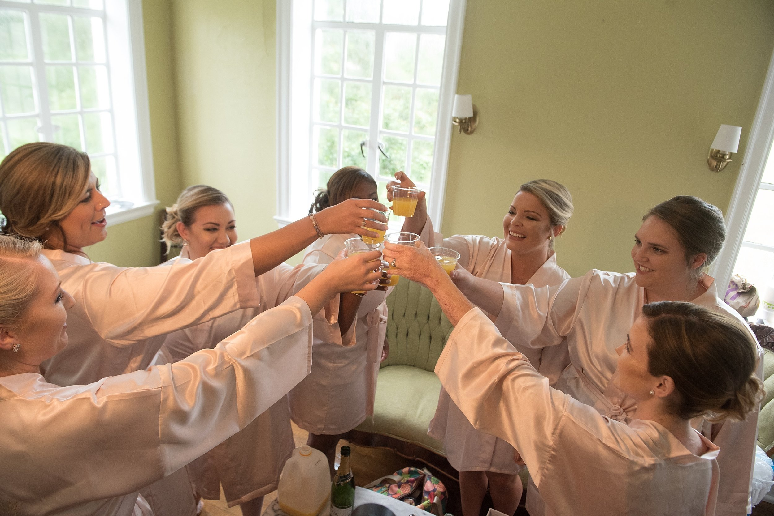 Bridesmaids make a toast to the bride
