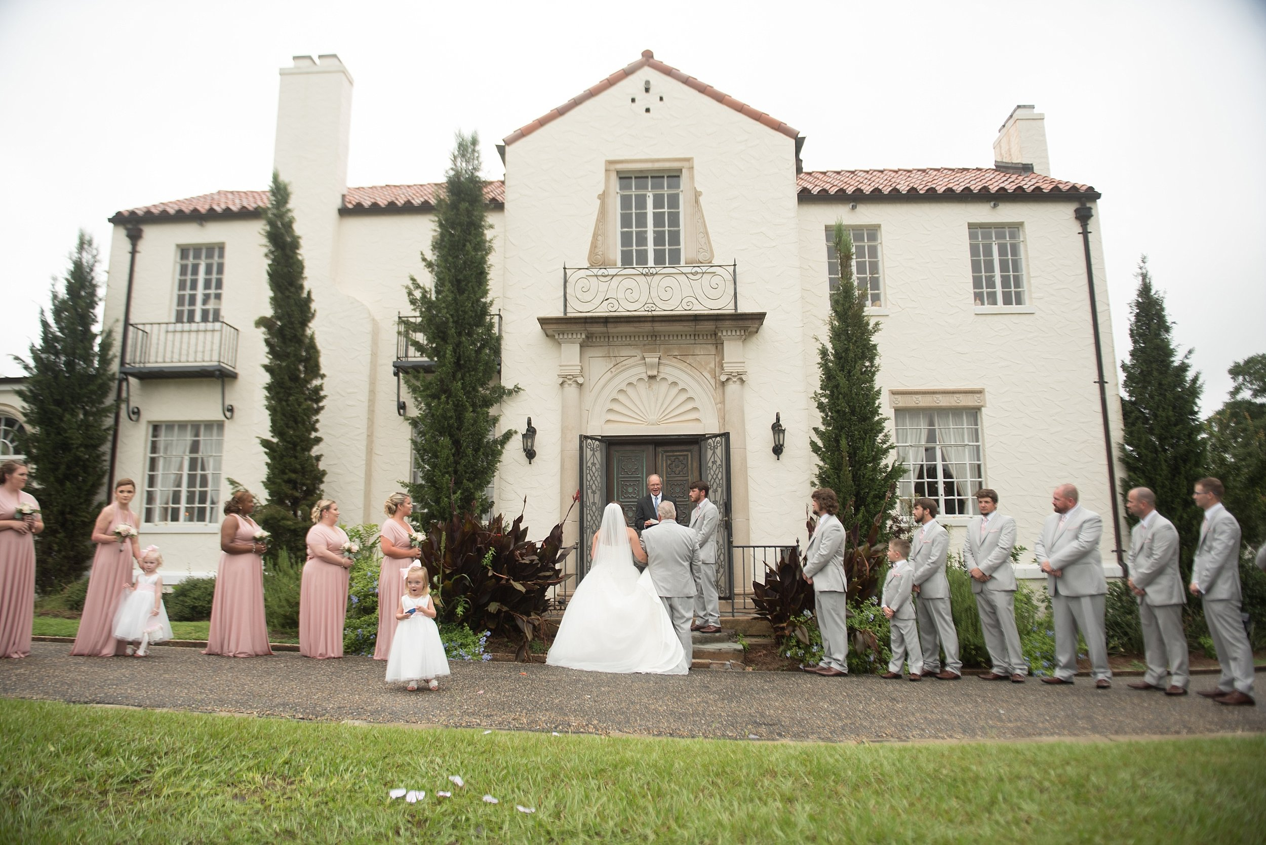A wedding ceremony in front of Springdale in Andalusia, Alabama
