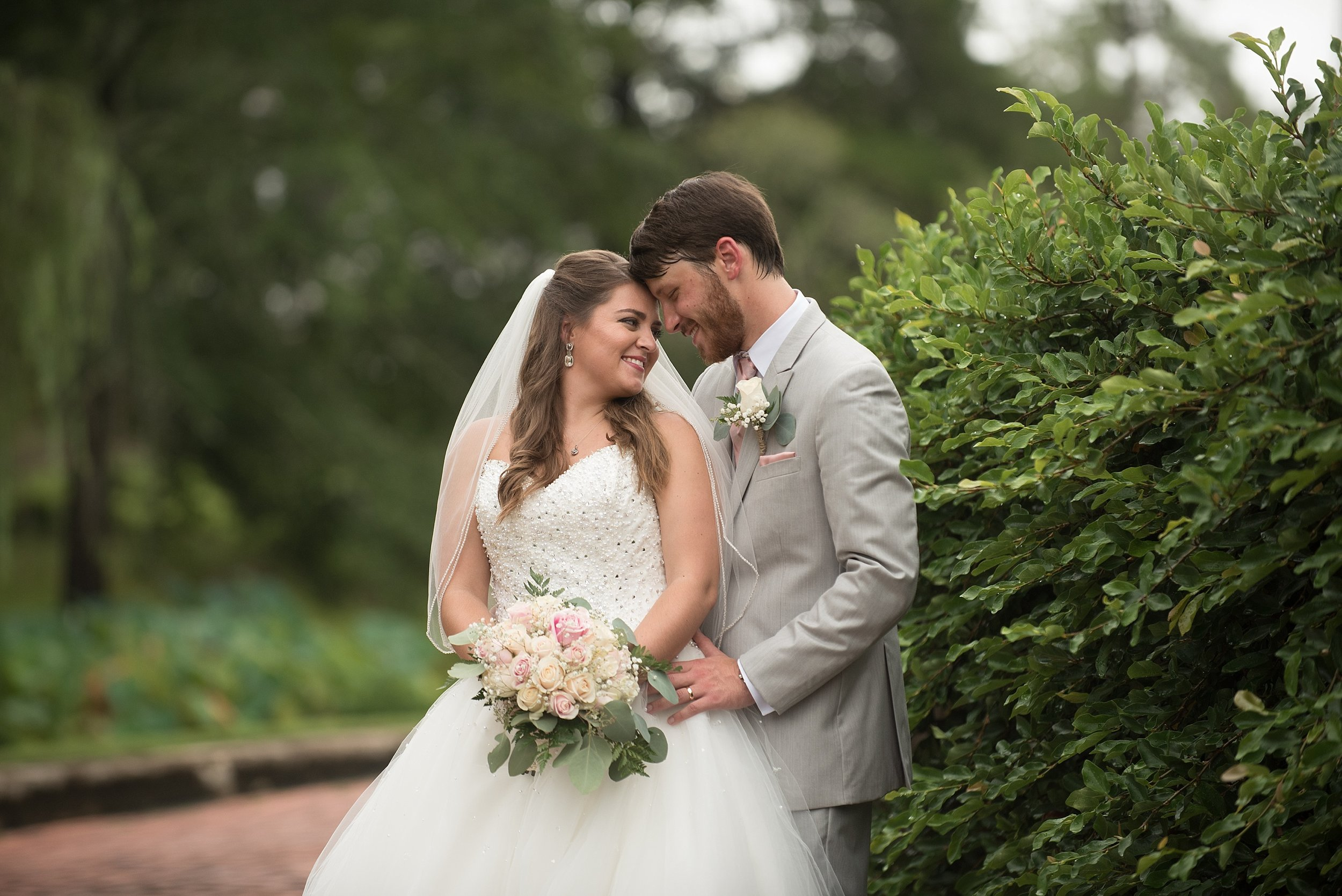 The newlyweds share a tender moment after the wedding ceremony