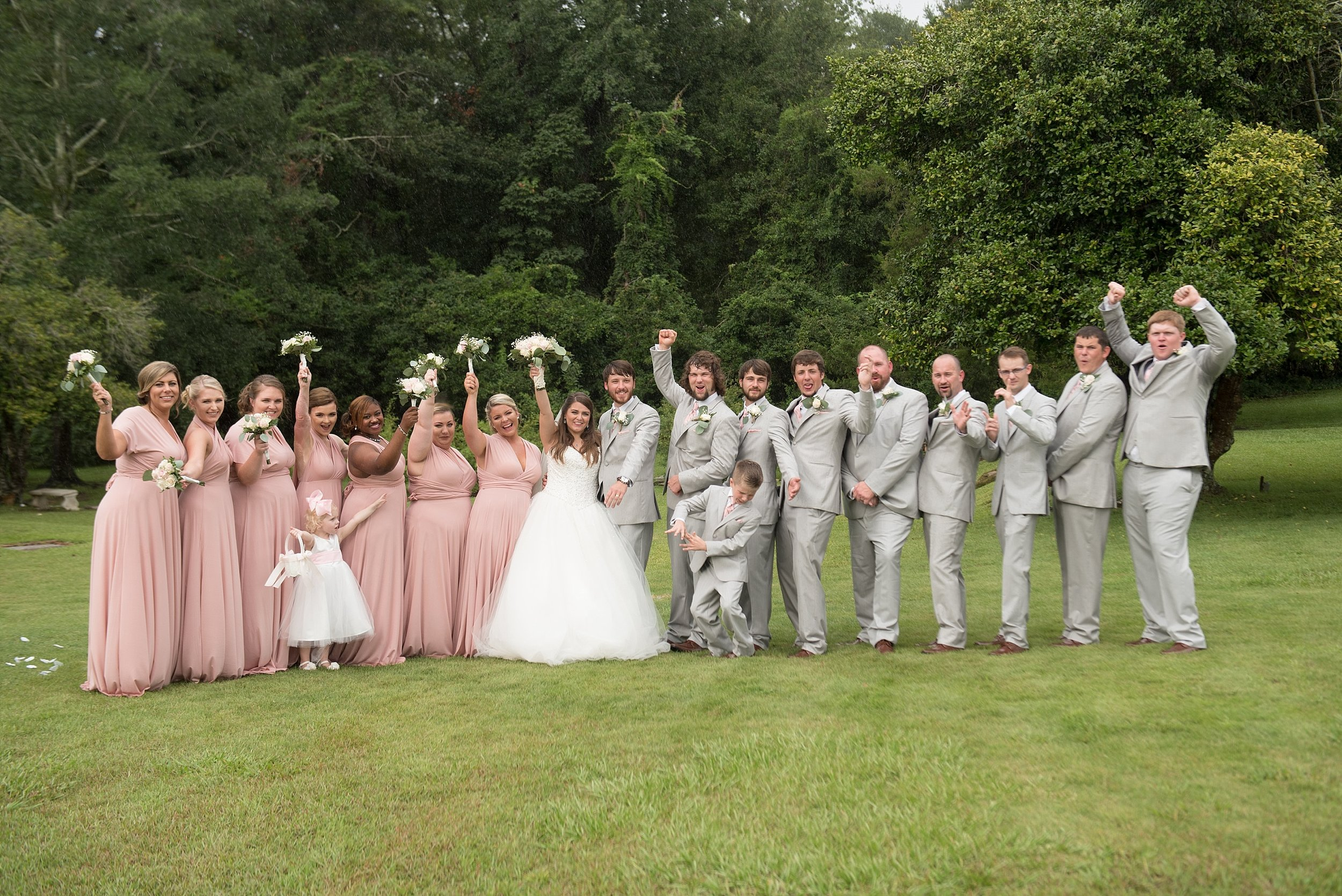 bridal party cheers for the bride and groom