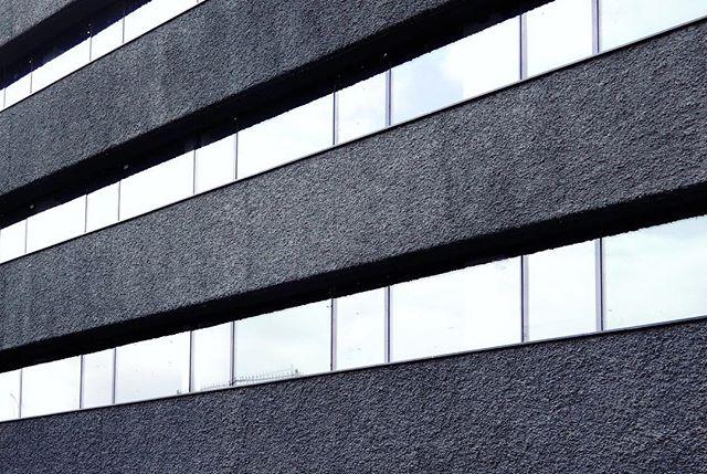 Stripes of rough dark concrete - Jordan Office Building in Tehran.  #office #officebuilding  #concrete #Tehran #Iran #facade #rough #stripe #bands #flexible #openoffice #art #architecture #black #texture #noise #tone #architecture #experimental #interiordesign #archdaily #glass #grid #instagram