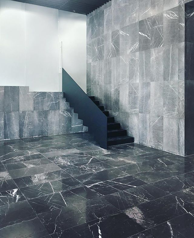 Lobby space and access to the multi-purpose hall - Jordan Office Building in Tehran #lobby #stairs #steel #grey #architecture #interiordesign #stone #step #archdaily #art #office #building #interior #tehran #iran #instagram