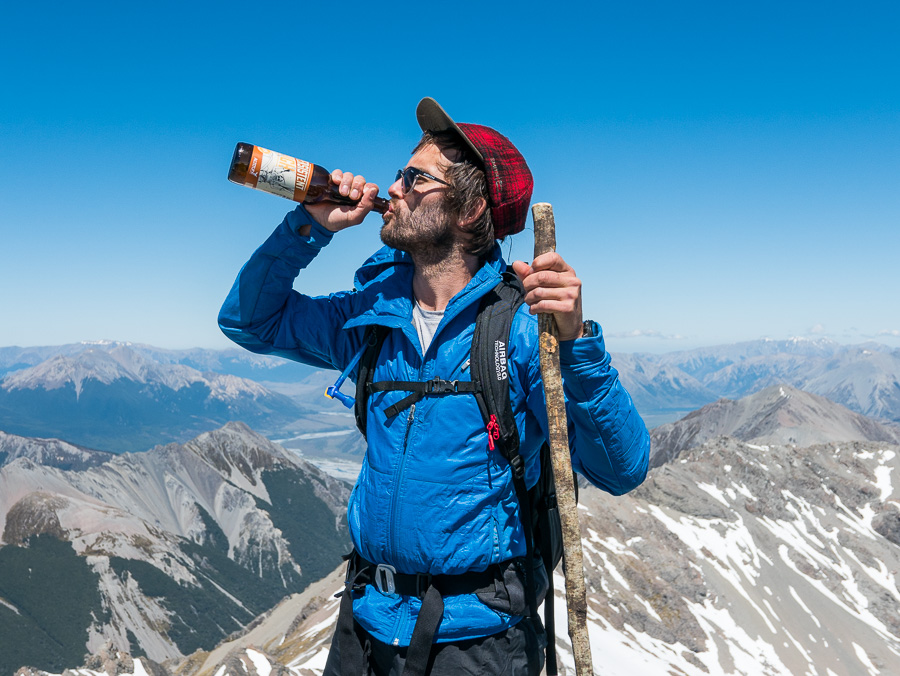 Pete drinking an Altitude Beer at the summit, very appropriately called the 'Persistent High'. Photo: Tom Powell