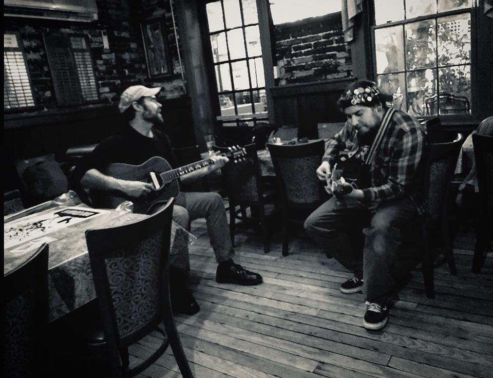 Backroom pickin'. (left) Konrad Wert - Possessed By Paul James • (right) Aaron Yealdhall of skribe • Photo: Cory Streett