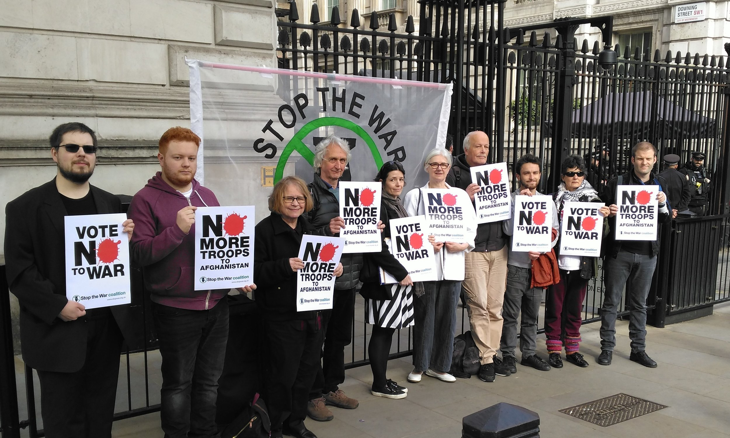 PeaceLine editor Jim Brann (4th right) and London CND chair Carol Turner (5th right) joined a Stop the War's protest at Downing Street earlier this year.