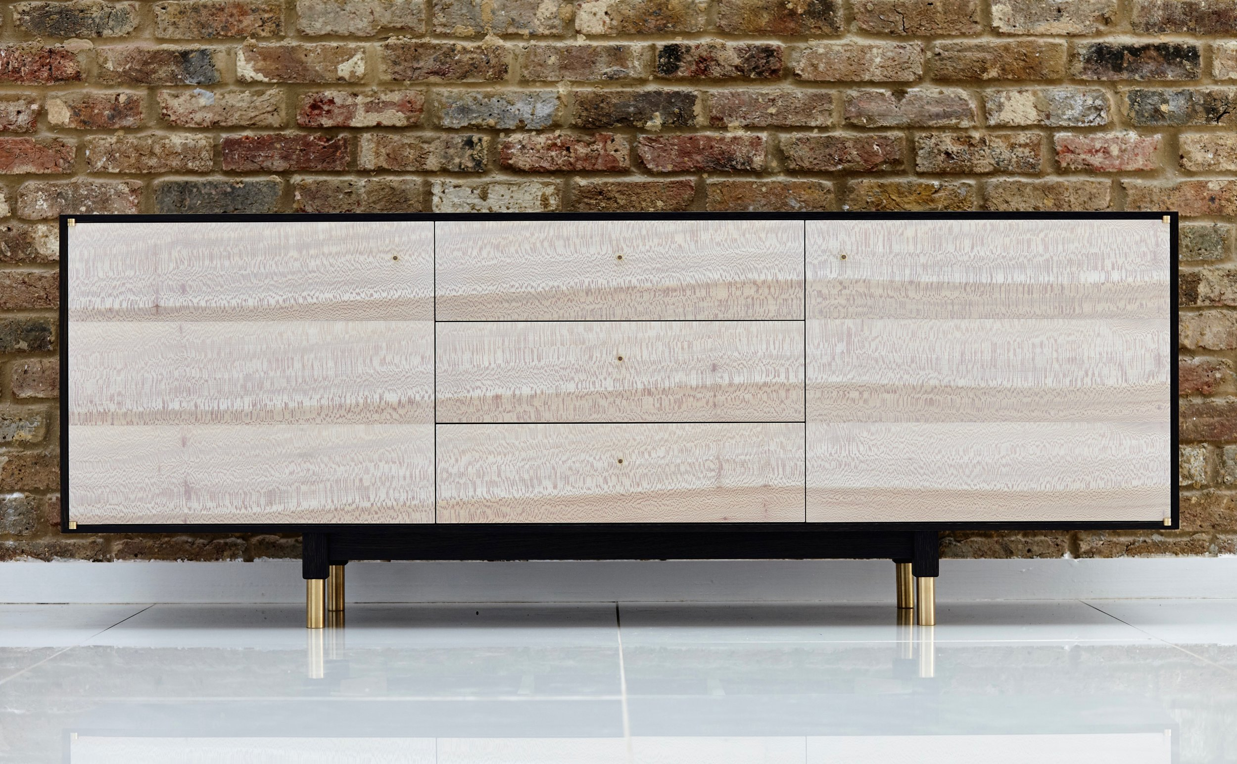 RHMB - RHMB was founded by Robert Brain, an extraordinary cabinet maker with an eye for sourcing traditionally unused woods such as London Plane. Over the last decade, RHMB has primarily focused on producing high-end cabinetry for private clients. Robert's growing furniture collections have been showcased at The London Art Fair and Decorex International. Notable press include The FT's How To Spend It, City AM and Design Milk.