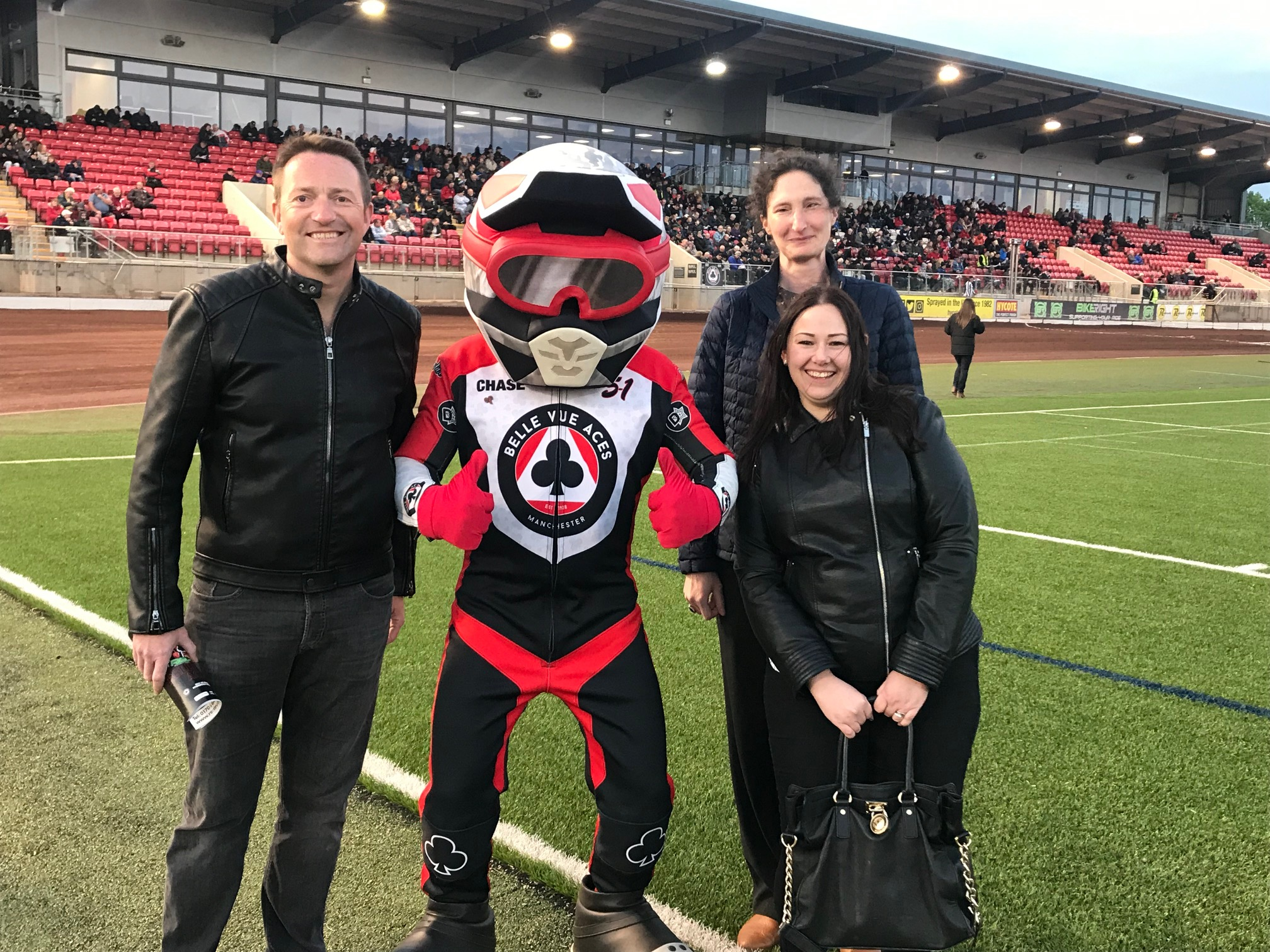 Team Thorneycroft: Mark Belfield, Mary Lomas and Sarah Coxon with Belle Vue mascot Chase The Ace