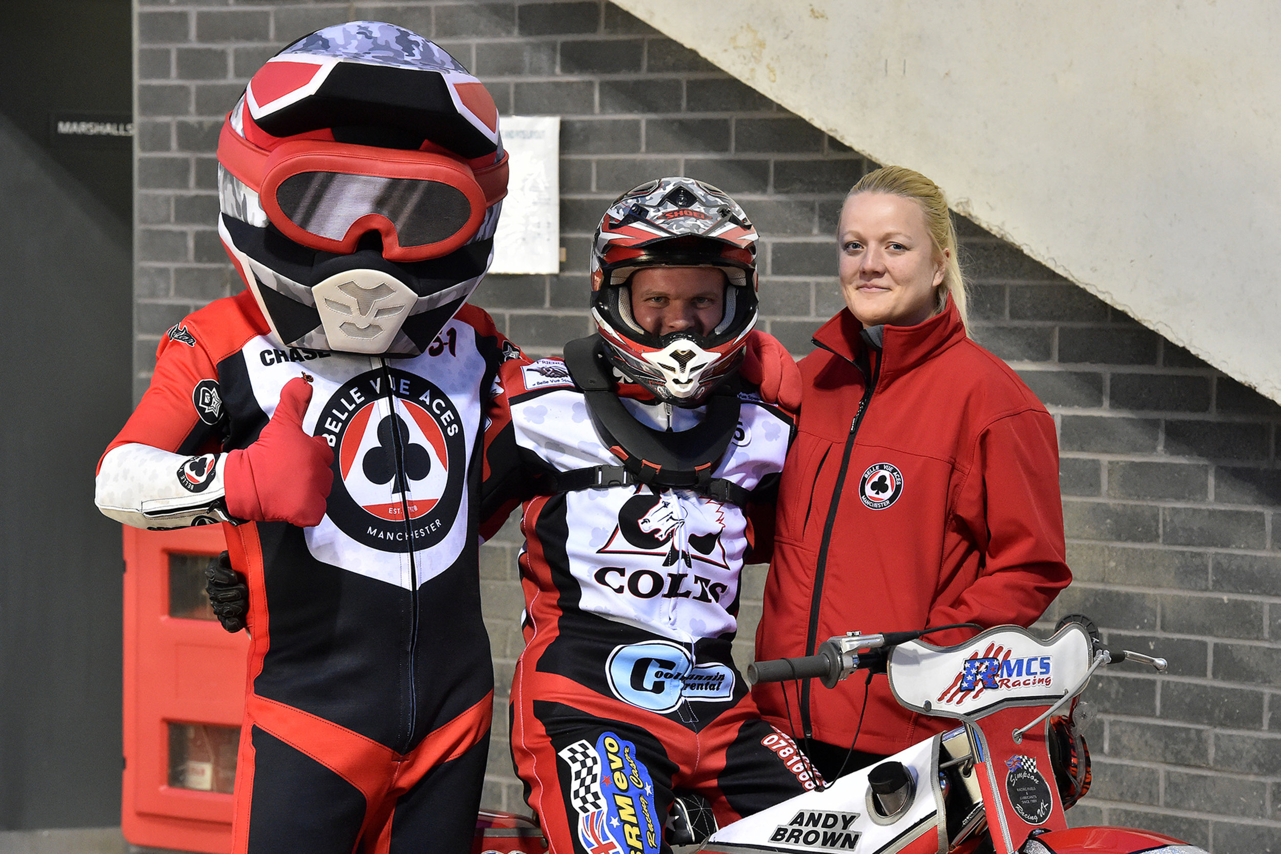 Andy Mellish (centre) with wife Danielle (right) and Belle Vue mascot Chase The Ace