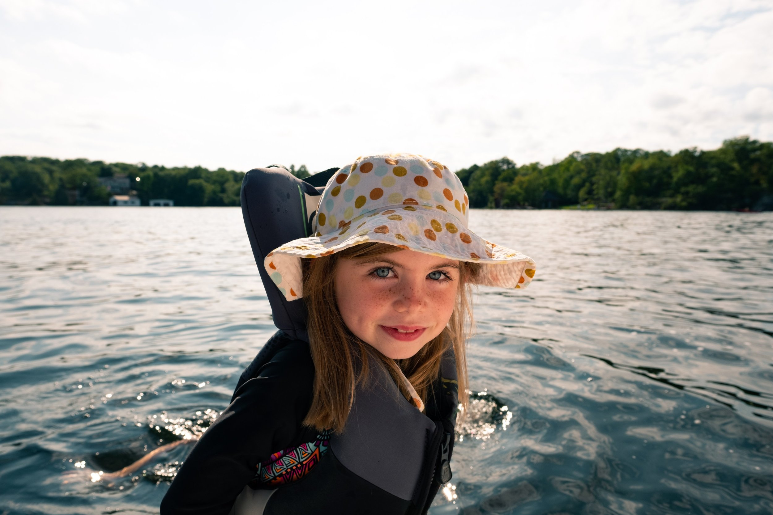 child-in-life-jacket-on-boat_4460x4460.jpg