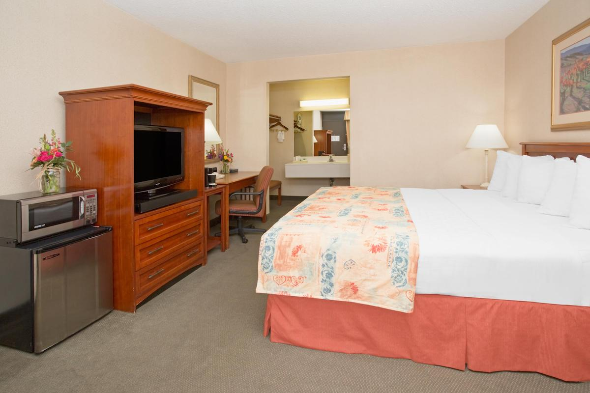 king bedroom at durango downtown inn with fridge, tv and microwave.jpg